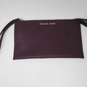 Michael Kors Jet Set LG ZIP leather clutch